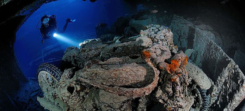 Diver looks at motorbikes on Thistlegorm Wreck