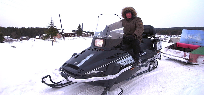 Brian driving Skidoo in snow